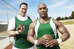 Shot Putters Holding Shot Put And Discus Stock Photos