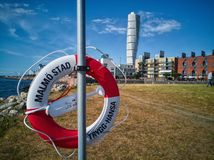 Rescue Buyou and Turning Torso. A shot of a rescue buyou against the backdrop of Western Harbour area in Malmo, Sweden Royalty Free Stock Photography