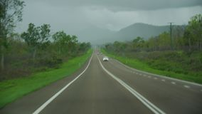 Road tripping under a bad weather. A shot of the road while having a road trip. A bad weather is approaching. A storm is seen from a far stock video footage