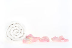 Shot of roll of towel with petals in a spa Royalty Free Stock Photo
