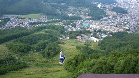 Shot of sapporro city from the top of mountain moiwa, hokkaido,japan. Wide shot of sapporro city from the top of mountain moiwa, hokkaido,japan stock footage