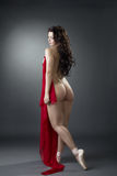 Shot of sexy dancer posing naked with red cloth Stock Images