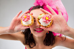 Glamour girl with a cakes Royalty Free Stock Photo