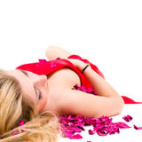 woman in red dress with rose petals Stock Photography