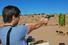 SHOT Show Media Day, Shooting. Test firing a .357 Magnum at SHOT Show Media Day in Boulder City, Nevada on January 17, 2011 royalty free stock photography