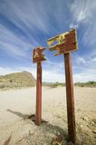 Shot sign. Sign shot into two sections in desert Stock Images