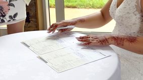 Signing of marriage register or guest book. Shot of signing of marriage register or guest book stock video footage