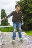Shot of sliding rollerskater in protection kit. Shot of concentrated sliding rollerskaters in protection kit Royalty Free Stock Images