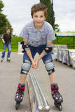 Shot of sliding rollerskaters in protection kit. Shot of smiling sliding rollerskaters in protection kit Royalty Free Stock Photo