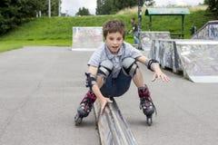 Shot of  sliding rollerskaters in protection kit. Shot of smiling sliding rollerskaters in protection kit Stock Photo