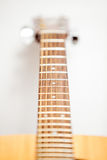 Shot with small depth of focus of guitar fingerboard Royalty Free Stock Images