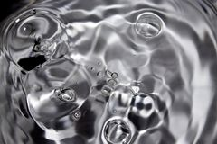 Shot Of Some Random Water Drops. Black and white macro shot of some random water drops stock images