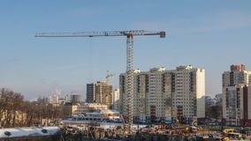 Cranes working on construction site residential housing estate building technology in process. Shot with sony a6500 in time lapse mode. Tower cranes working on stock footage