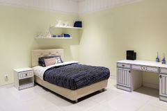 Shot of a spacious cosy children's room. Clean, beautiful stylish room for the teen royalty free stock photos