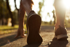 Shot of sportsman, athlete or runner shoes on road. Stock Image
