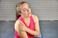 My shoulder hurts. Shot of a sportswoman with a shoulder injury stock photography