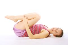 Shot of a sporty young woman doing yoga exercise. Stock Photos