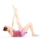 Shot of a sporty young woman doing yoga exercise. Royalty Free Stock Photos