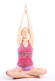 Shot of a sporty young woman doing yoga exercise. Royalty Free Stock Images