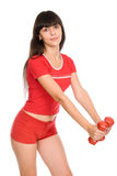 Shot of a sporty young woman with dumbbells Royalty Free Stock Image