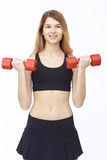 Shot of a sporty young woman with dumbbells. Royalty Free Stock Photography
