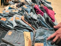 Shot of a stand selling vintage jeans stock photography