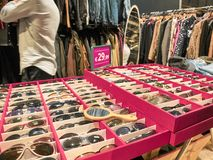 Shot of a stand of vintage sunglasses stock photography