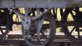 Shot of steam train carriages on track, wheels only 4K. Steam train carriage wheels on track with sound of steam train 4K stock video
