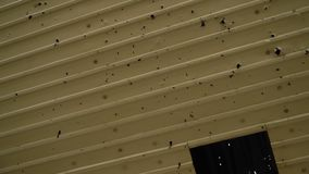 Trace of bullet marks on steel. A shot of steel sheet covered with bullet strays stock video