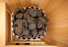 Shot of stones in sauna oven Stock Image