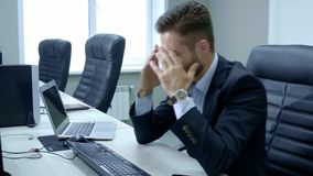 Shot of stressed business man in the office