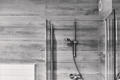 Shot of a stylish black and white bathroom with a shower head. Shot of a stylish black and white bathroom with a shower Stock Photo