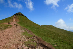 A shot of the summits of Corn du and Pen y Fanin the Brecon Beacons National Park. A shot along the hiking trail. Of the twin peaks of Corn du and Pen y Fan in Stock Image