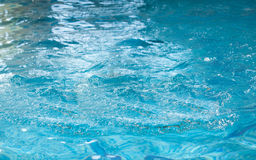 Shot of surface of water in swimming pool. Closeup shot of surface of water in swimming pool stock photography