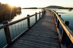 The wooden trestle along the lake stock photography