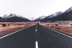 A shot taken at the middle of the road giving a unique perspective. A beautiful shot of New Zealand landscape royalty free stock photo
