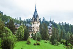 Peles Castle in Romania. This shot is taken in Prahova County, Romania at the Peles Castle. It is a Neo-Renaissance castle in the Carpathian Mountains built Royalty Free Stock Image