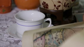 Shot of tea cups and a jar on the table stock video footage