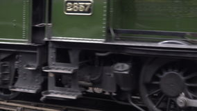 Shot of team wheels leaving station with sound 4K. Steam train wheels and sound of engline 4K stock footage