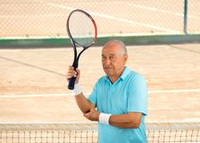 Injured tennis sportsman. Shot of a tennis player with a elbow injury on a clay court royalty free stock photo