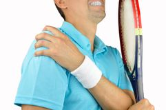 Player with pain in shoulder. Shot of a tennis player with a shoulder injury isolated over white background Stock Photo