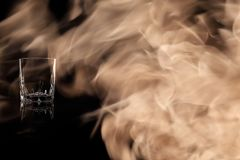 A shot of tequila, vodka or whiskey in the fire flames. Stock Images