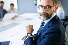 Shot of thinking financial advisor businessman working in office. stock photo