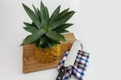 Pineapple cut with slices and knife royalty free stock photos