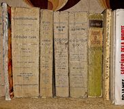 Old books on wooden shelf. royalty free stock images