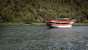Shot of the touristic boat floating on the river stock footage