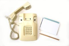 Isolate beige old telephone with wire tube lies on white background royalty free stock image