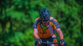 Shot of two bikers racing in marathon. VRHNIKA, SLOVENIA - JUNE 2014: Bicycle marathon competition around Vrhnika. Two bikers cycling uphill stock video footage