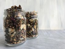 Shot of two jars of granola set on light grey tabletop royalty free stock photo