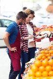 Two young sellers doing inventory in health grocery shop. Shot of two young sellers doing inventory in health grocery shop royalty free stock photography